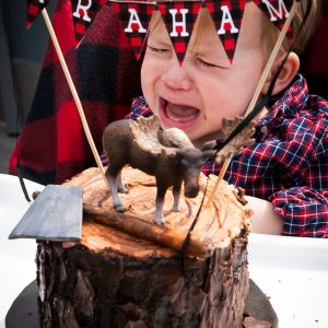 Little lumberjack first birthday party birthday boy smash cake
