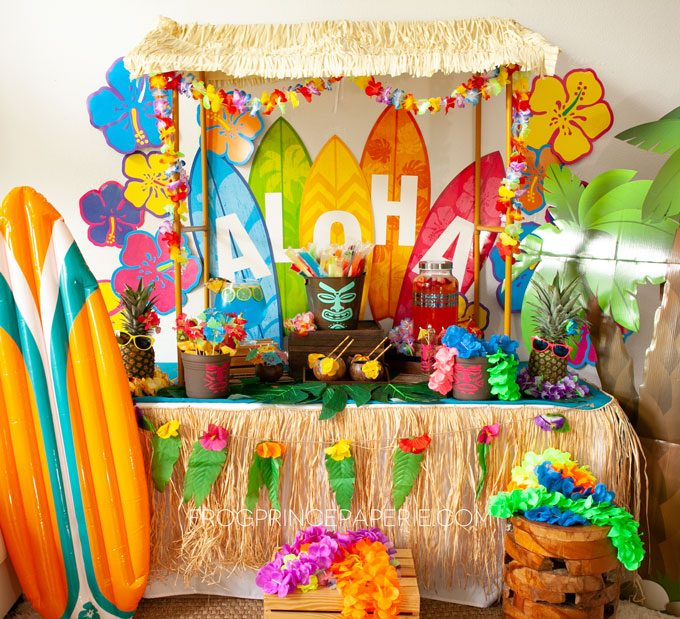 Easy luau party ideas for an easy tiki bar. DIY Tiki bar with purchased luau party supplies and a few Cricut touches!