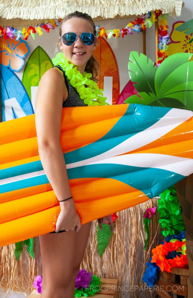Easy luau party ideas -- inflatables and palm tree cut outs make perfect photo props.