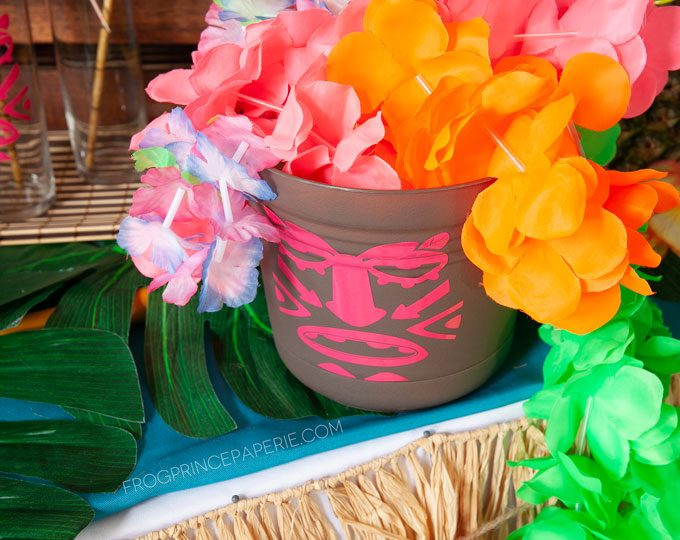 DIY luau tiki bucket for holding drinks, leis and other things for your luau party
