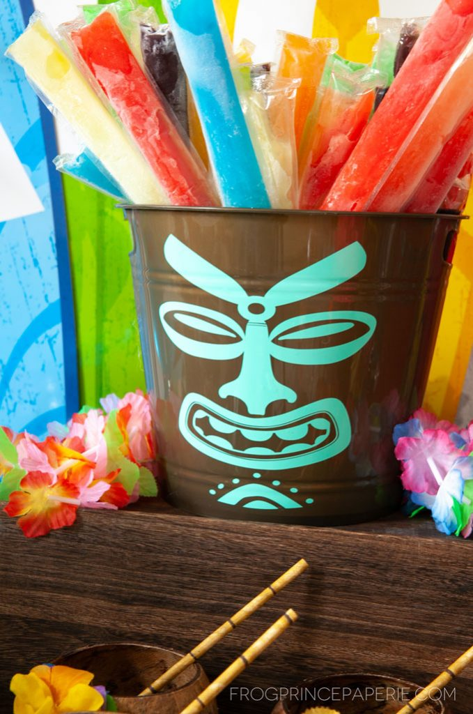 Easy luau party ideas for a simple to put together tiki bar! Tiki buckets are great for holding popsicles.