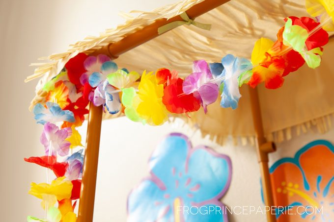 Easy luau party ideas for a simple to put together tiki bar--flower garlands make great accents!