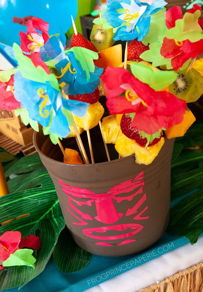 Easy luau party ideas for an easy tiki bar. DIY Tiki buckets are great for holding fruit skewers.