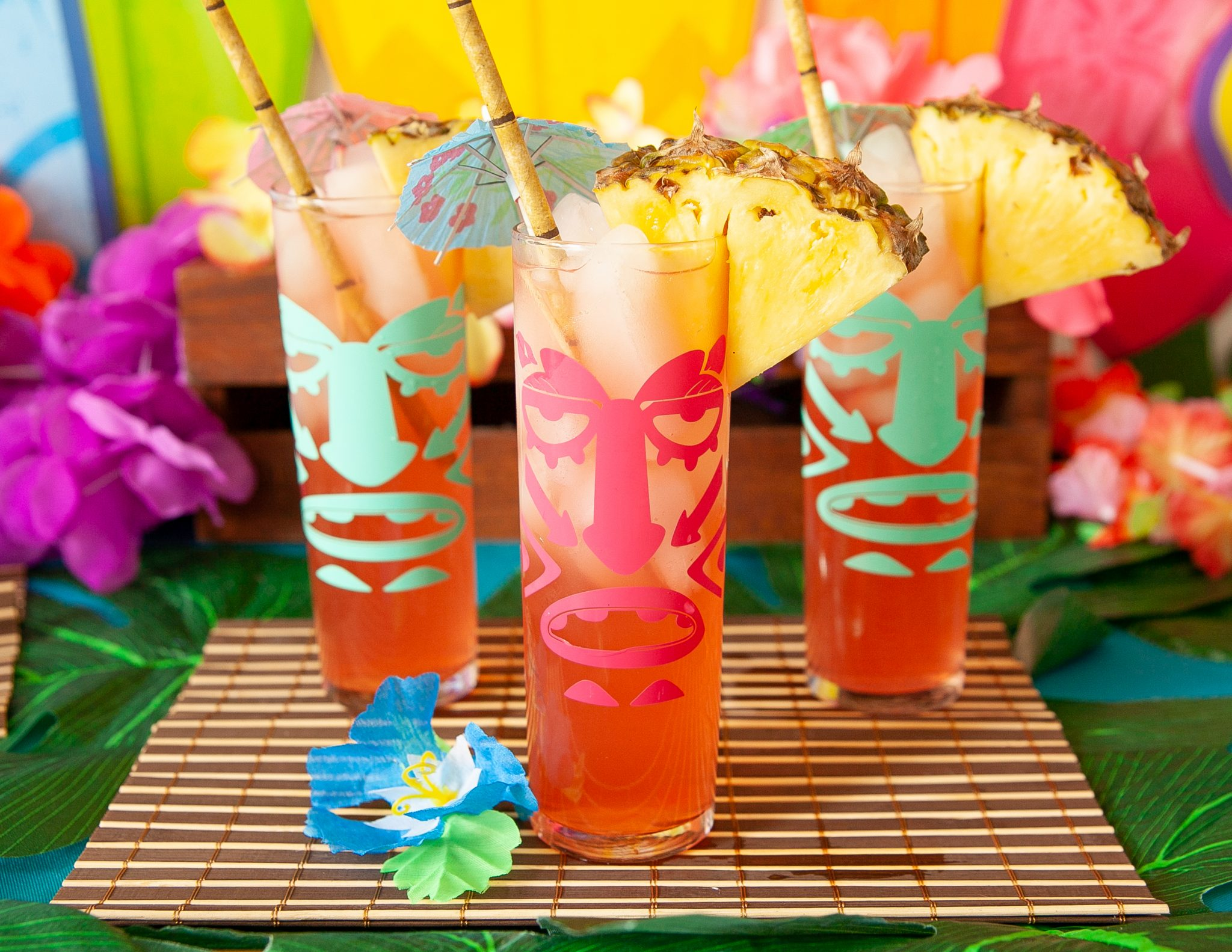 DIY tiki glasses using a free tiki svg file perfect for any luau party