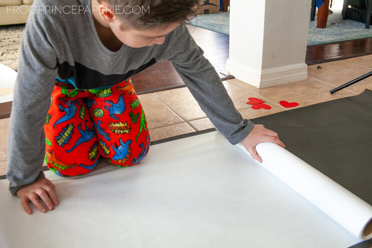 Roll out white paper to start your kid art project at home--sending a hug!