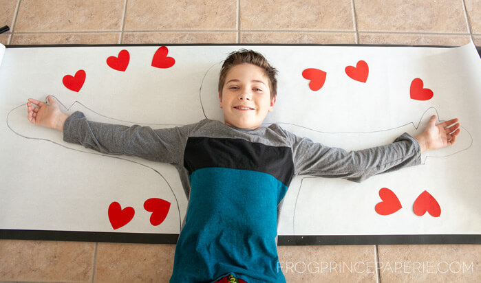 Trace your kid to make this at home art project for kids--sending hugs in the mail!