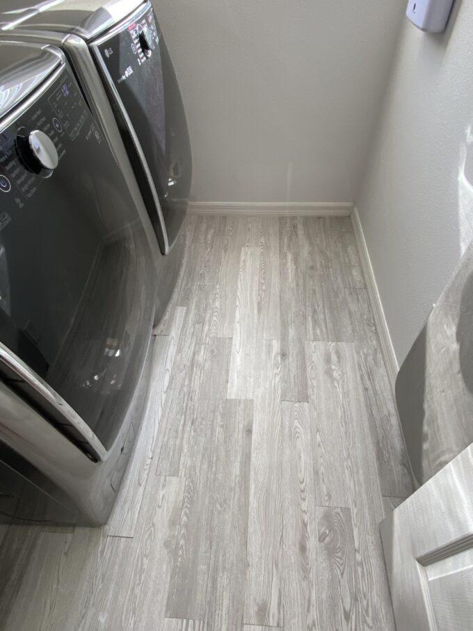 Laundry room decor idea - vinyl plank floors