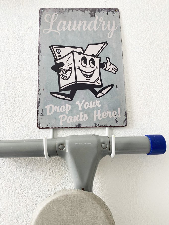 Laundry roon ironing board holder with sign
