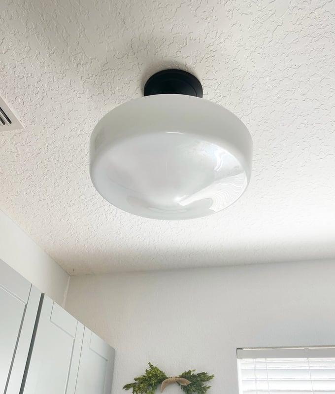 DIY laundry room decor ideas - schoolhouse light fixture