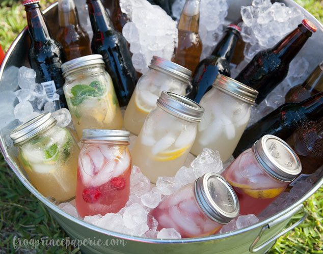 Backyard movie party beverages in a barrel. Pre-make cocktails for adult individual servings