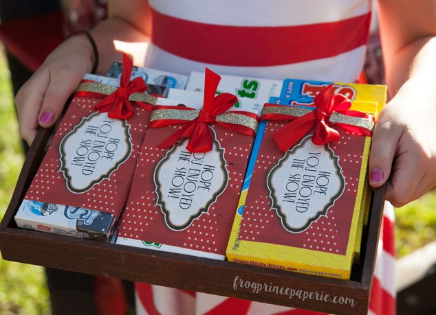 Concession style movie candy can be wrapped up for party favors at a backyard movie party