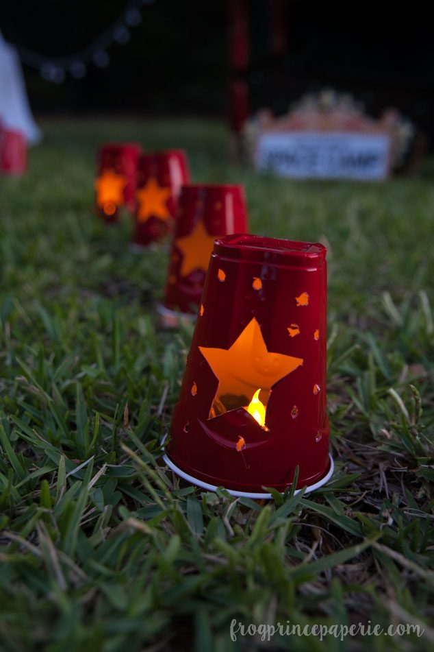Solo cups turned footlights add ambiance to a backyard movie party