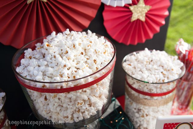 Large bowls of popcorn are the base for popcorn treats at this backyard movie party