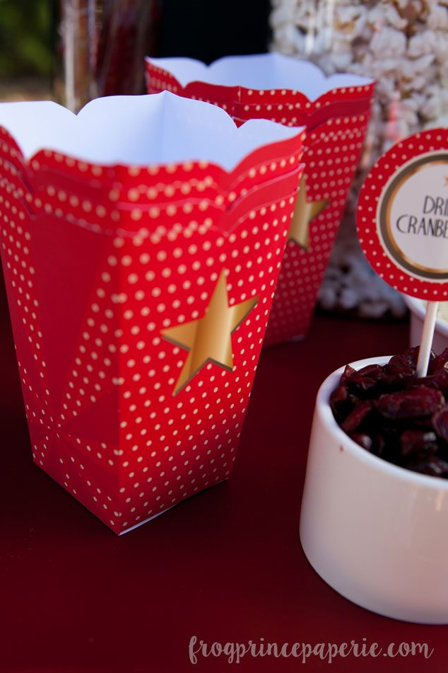 Paper popcorn boxes are perfect for serving at a backyard movie party!