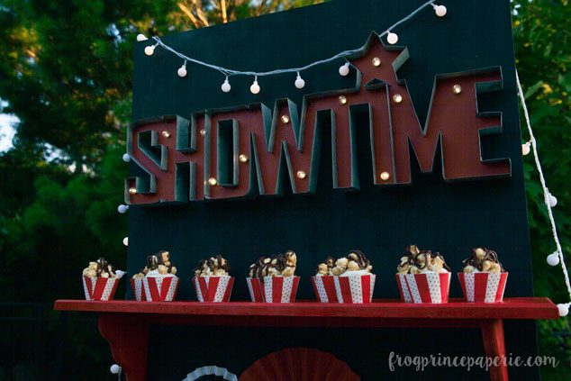This backyard movie party has caramel popcorn cupcakes for showtime!