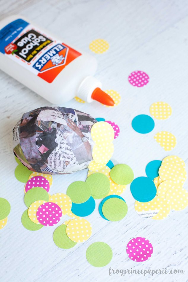 Have family craft time making paper mache Easter eggs this spring! After making your paper mache eggs. Then use pops of colorful paper circles to cover them for a fun Easter display!