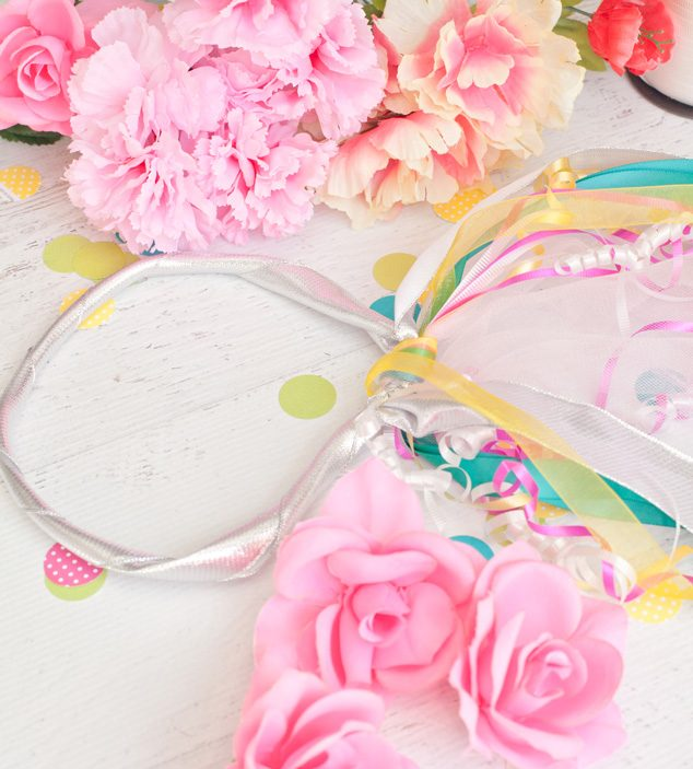 This quick kid craft to make a DIY fairy headband will keep the kids entertained for hours! Faux flowers make them fancy!