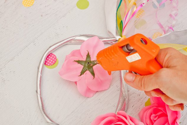 This quick kid craft to make a DIY fairy headband will keep the kids entertained for hours! Flowers, ribbon and glue are all you need.