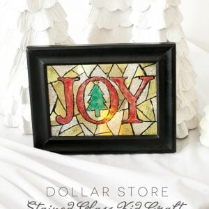 A great Christmas kid craft to make pretty stained glass pieces out of Dollar Store Frames!