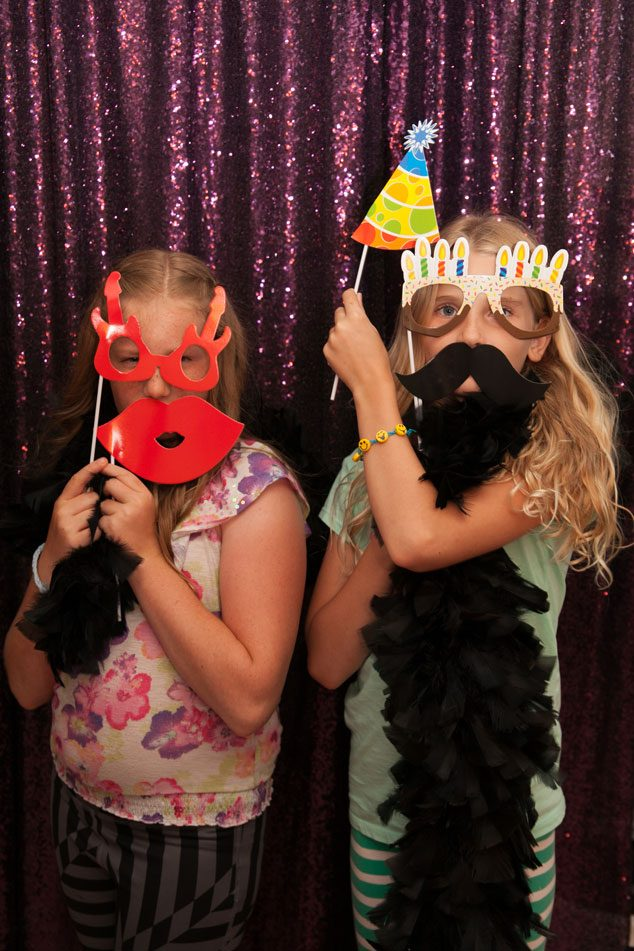 Emoji party activity: glamming it up in thephoto booth!