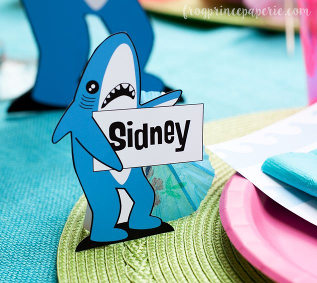 Make incredibly cute place card holders and food labels for your pool party with a little help from left shark!