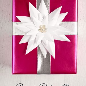 Christmas gift wrapping idea: how to make a paper poinsettia