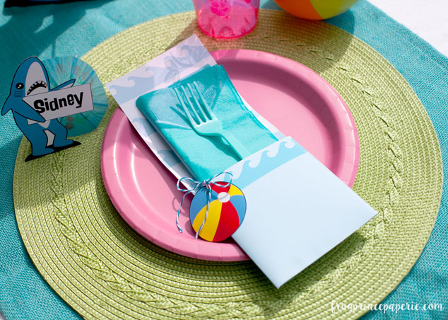 Printables make details easy! A folded utensil holder with a beach ball circle add some easy pop to pool party place settings