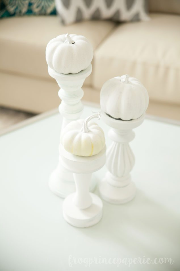Recycle old home decor for your fall decorations to make these darling pumpkin candlesticks!