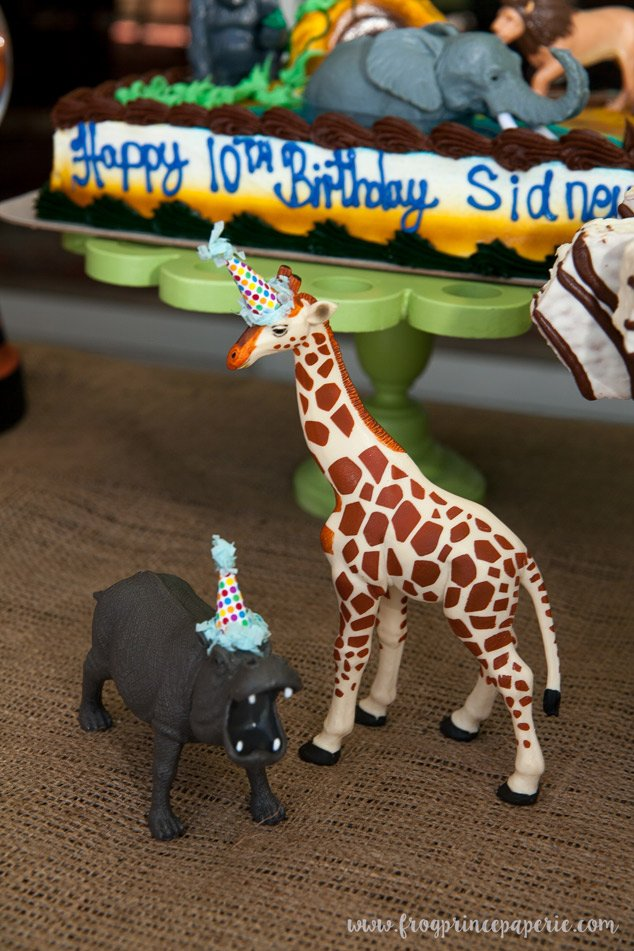 Animals in party hats at a safari birthday party