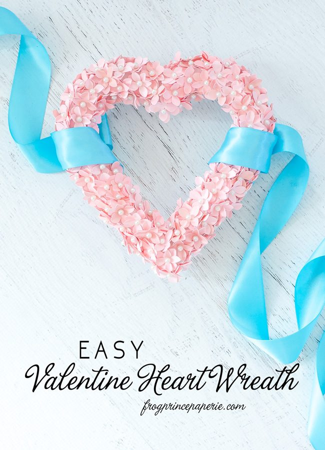 Make a Valentine DIY Heart wreath with corsage pins and pink cardstock. Super simple to do and beautiful Valentine's Day decor to display!
